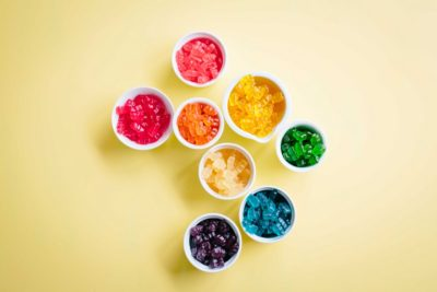 colorful gummies in cups