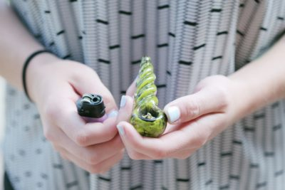 small glass pipe with marijuana