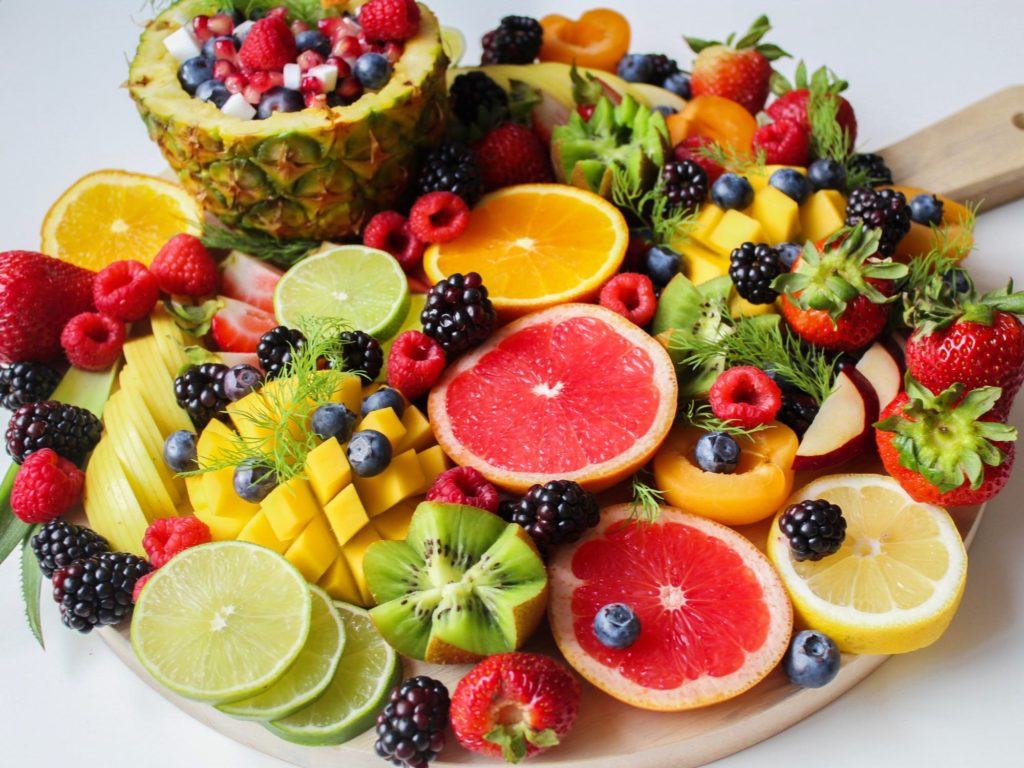 Assorted sliced fruit on a tray