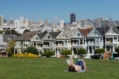 Woman reading book in San Francisco park