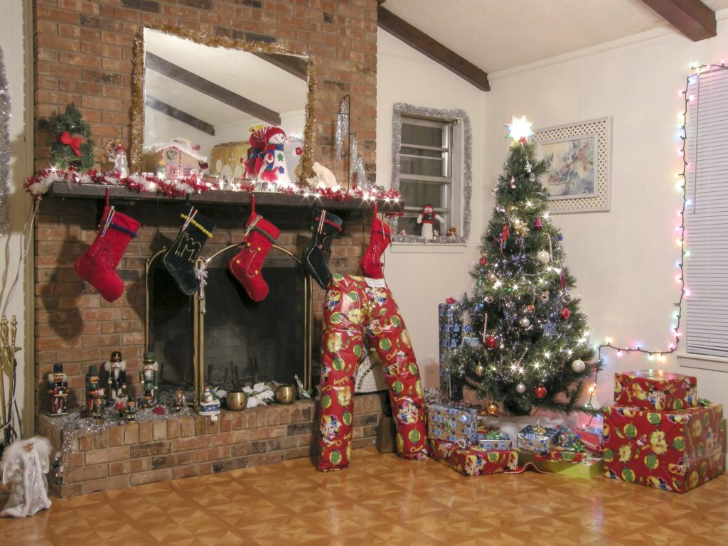 Living room with Christmas decorations and gifts